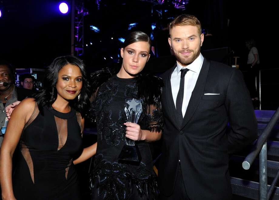 (L-R) Actress Nia Long, actress Adèle Exarchopoulos (holding the Critics' Choice Award for Best Young Actor/Actress award for 'Blue Is the Warmest Colour') and actor Kellan Lutz attend the 19th Annual Critics' Choice Movie Awards at Barker Hangar on January 16, 2014 in Santa Monica, California. Photo: John Sciulli, Getty Images