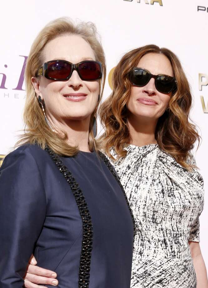 Actresses Meryl Streep (L) and Julia Roberts attend the 19th Annual Critics' Choice Movie Awards at Barker Hangar on January 16, 2014 in Santa Monica, California. Photo: Christopher Polk, Getty Images