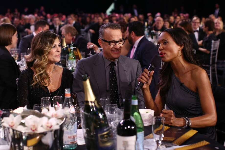 (L-R) Rita Wilson, actor Tom Hanks, and host Aisha Tyler attend the 19th Annual Critics' Choice Movie Awards at Barker Hangar on January 16, 2014 in Santa Monica, California. Photo: Christopher Polk, Getty Images