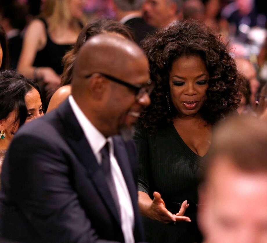 Actors Forest Whitaker (L) and Oprah Winfrey attend the 19th Annual Critics' Choice Movie Awards at Barker Hangar on January 16, 2014 in Santa Monica, California. Photo: Christopher Polk, Getty Images