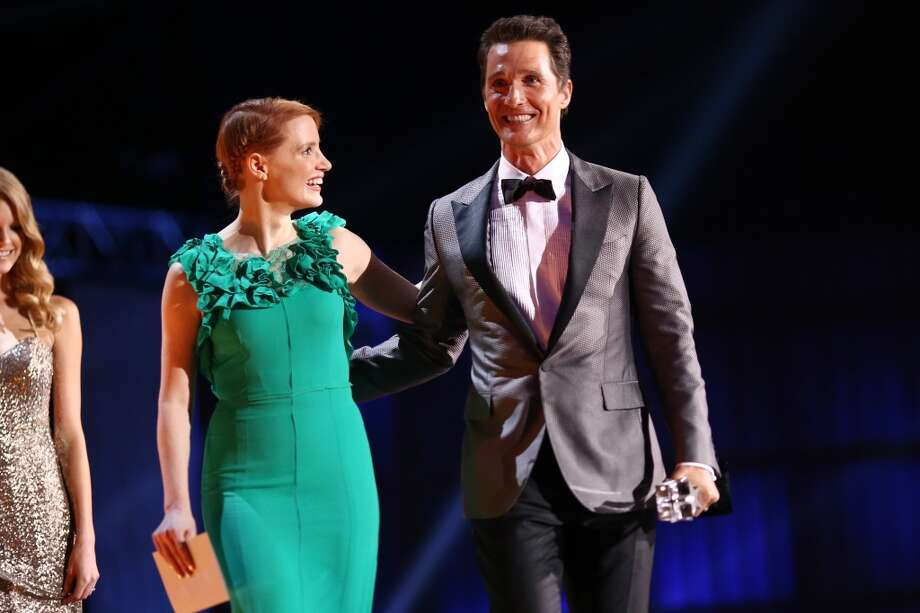 Actress Jessica Chastain (L) and actor Matthew McConaughey (holding the Critics' Choice Award for Best Actor for 'Dallas Buyers Club') walk onstage at the 19th Annual Critics' Choice Movie Awards at Barker Hangar on January 16, 2014 in Santa Monica, California. Photo: Christopher Polk, Getty Images