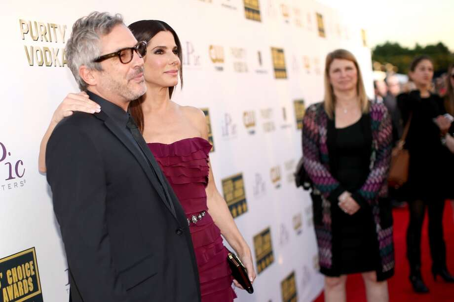 Filmmaker Alfonso Cuaron (L) and actress Sandra Bullock attend the 19th Annual Critics' Choice Movie Awards at Barker Hangar on January 16, 2014 in Santa Monica, California. Photo: Christopher Polk, Getty Images