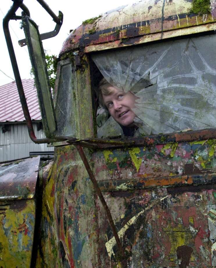 In this Dec. 7, 2005 file photo, Zane Kesey looks through the broken driver's side window of the 1939 International school bus his father, the late author Ken Kesey, rode into psychedelic history in 1964 with the Merry Pranksters, as it sits on the family farm in Pleasant Hill, Ore. Photo: JEFF BARNARD, AP