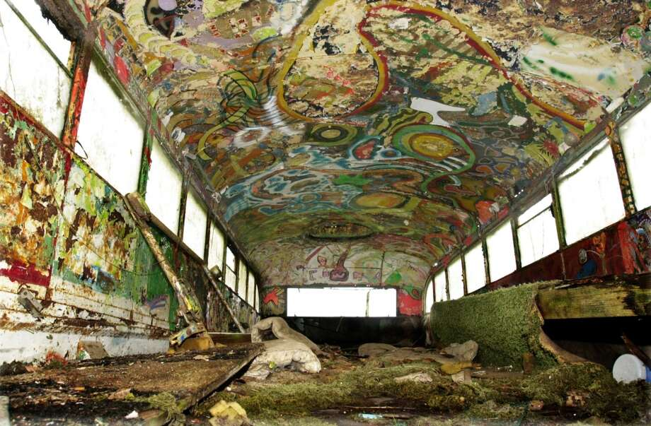 Moss, swirls of brightly colored paint and patches of rust cover the inside of this 1939 International Harvester school bus Dec. 7, 2005, in Pleasant Hill, Ore. Photo: JEFF BARNARD, AP