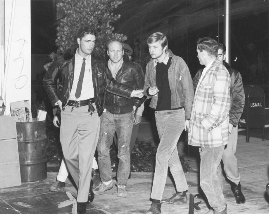 Sheriff Russell Gropp, Ken Kesey, Lee Quarnstrom and Neal Cassady (left to right) on April 24, 1965. Photo: Rodman Bingham