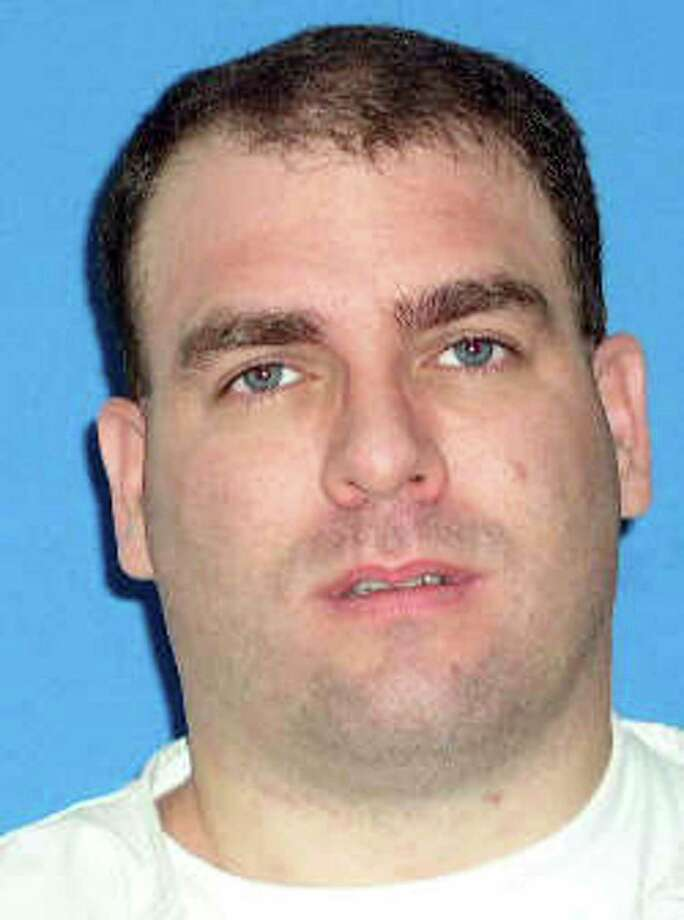 This photo released by the Texas Department of Criminal Justice shows death row inmate Larry Ray Swearingen, 37, who was scheduled for execution Tuesday, Jan. 27, 2009 at the Texas prison in Huntsville, for abducting, raping and strangling 19-year-old Melissa Trotter, whose body was found Jan. 2, 1999, in the Sam Houston National Forest south of Huntsville. The 5th U.S. Circuit Court of Appeals on Monday Jan. 26, 2009 stopped Swearingen's execution. The reprieve came in response to questions from Swearingen's attorneys about the timing of Trotter's death. Swearingen insisted he couldn't have killed the woman because he was in jail for outstanding traffic warrants when newly evaluated forensic evidence indicates her body was dumped in the woods not far from his home. (AP Photo/Texas Court of Criminal Justice) Photo: HO / Texas Department of Criminal Jus