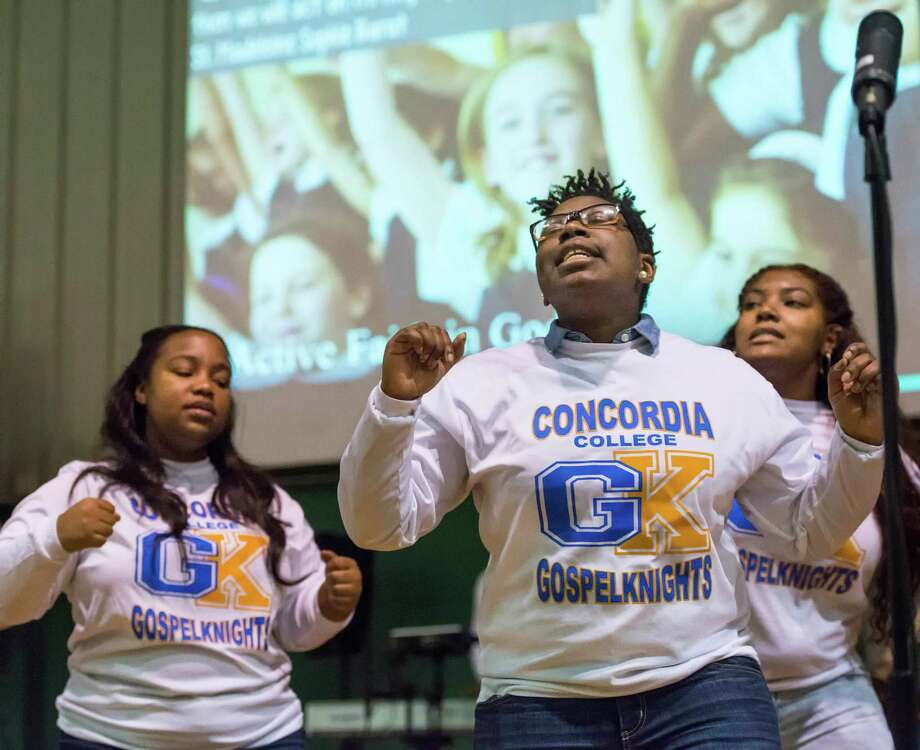 """Jessica Miller of the Concordia College Gospel Knights sings during a performance called """"Celebrating Dr. Martin Luther King Jr. - Be a force for change.""""  for the staff and students at the Convent of the Sacred Heart, Greenwich, CT on Friday, January, 17th, 2014. Photo: Mark Conrad / Connecticut Post Freelance"""