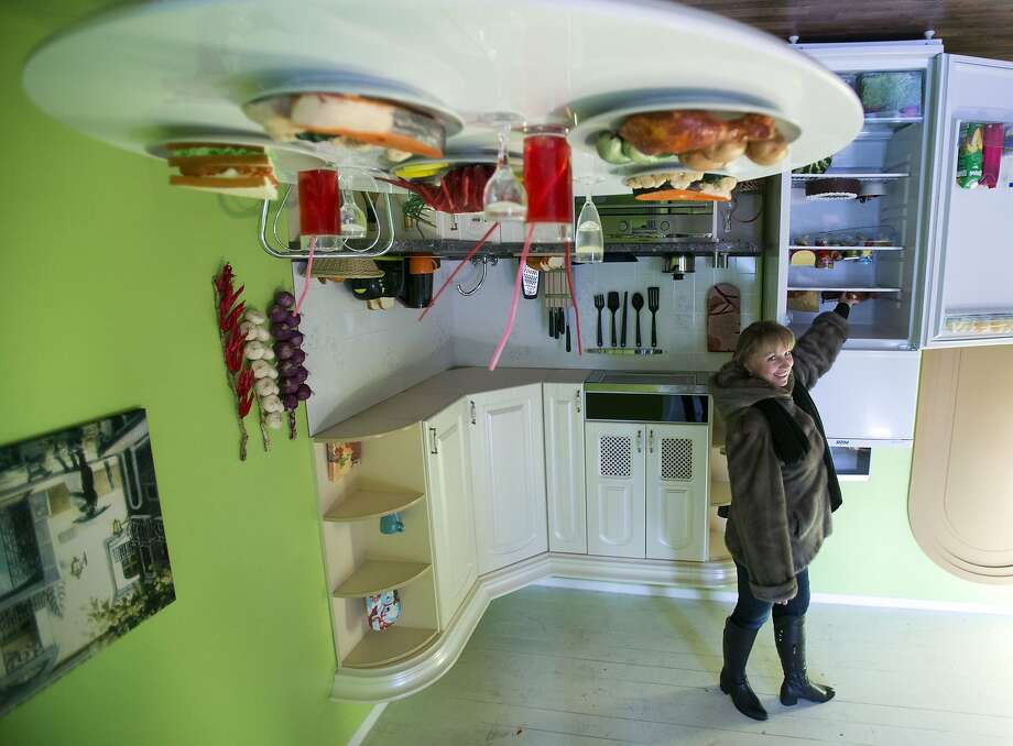 Don't trip over the chandelier:According to its designers, the Upside Down House at the All-Russia Exhibition Center in Moscow can cause dizziness. Photo: Pavel Golovkin, Associated Press