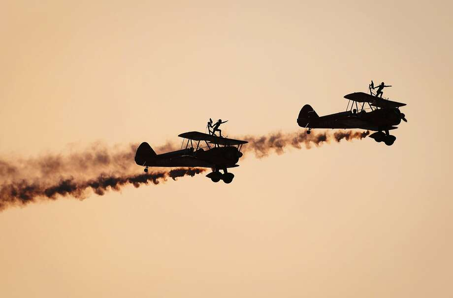 Barnstorming in Bahrain: Daredevils of the Breitling Wingwalkers perform during the opening of the Bahrain International Airshow in Sakhir. Photo: Mohamed Al-Shaikh, AFP/Getty Images
