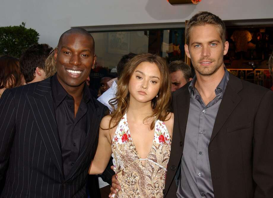 "Tyrese, Devon Aoki & Paul Walker during The World Premiere Of ""2 Fast 2 Furious"" in 2003. Photo: Gregg DeGuire, WireImage"