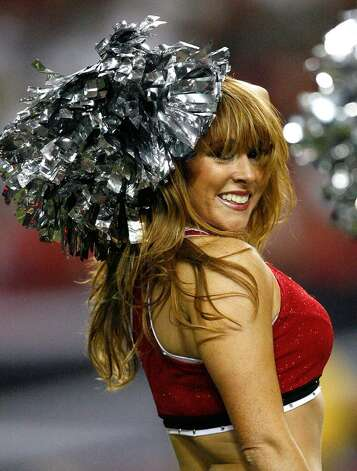 ATLANTA - SEPTEMBER 03:  A cheerleader of the Atlanta Falcons performs during the preseason game against the Baltimore Raves at Georgia Dome on September 3, 2009 in Atlanta, Georgia.  (Photo by Kevin C. Cox/Getty Images) Photo: Kevin C. Cox, Getty Images / 2009 Getty Im