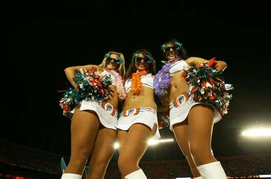 MIAMI - SEPTEMBER 21:  Cheerleaders perform along with parrotheads during half-time as the Indianapolis Colts take on the Miami Dolphins at Land Shark Stadium on September 21, 2009 in Miami, Florida. The Colts defeated the Dolphins 27-23.  (Photo by Doug Benc/Getty Images) Photo: Doug Benc, Getty Images / 2009 Getty Images
