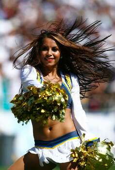 SAN DIEGO - SEPTEMBER 20:  A cheerleader performs during the game between the Baltimore Ravens and the San Diego Chargers at Qualcomm Stadium on September 20, 2009 in San Diego, California.  (Photo by Jeff Gross/Getty Images) Photo: Jeff Gross, Getty Images / 2009 Getty Images