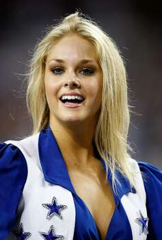 ARLINGTON, TX - SEPTEMBER 20:  Abigail Klein of the Dallas Cowboys cheerleaders performs at Cowboys Stadium on September 20, 2009 in Arlington, Texas.  (Photo by Ronald Martinez/Getty Images) Photo: Ronald Martinez, Getty Images / 2009 Getty Images