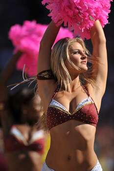 LANDOVER, MD - OCTOBER 4:  A cheerleader for the Washington Redskins cheers against the Tampa Bay Buccaneers during breast cancer awareness month at FedExField on October 4, 2009 in Landover, Maryland. The Redskins defeated the Buccaneers 16-13. (Photo by Larry French/Getty Images) Photo: Larry French, Getty Images / 2009 Getty Images