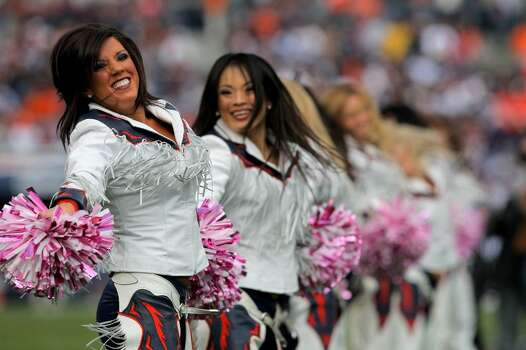 """DENVER - OCTOBER 04:  The Denver Broncos cheerleaders perform during a break in the action against the Dallas Cowboys during NFL action at Invesco Field at Mile High on October 4, 2009 in Denver, Colorado. The Broncos defeated the Cowboys 17-10. The cheerleaders used pink poms as part of the NFL's breast cancer awareness program """"A Crucial Catch""""  (Photo by Doug Pensinger/Getty Images) Photo: Doug Pensinger, Getty Images / 2009 Getty Images"""