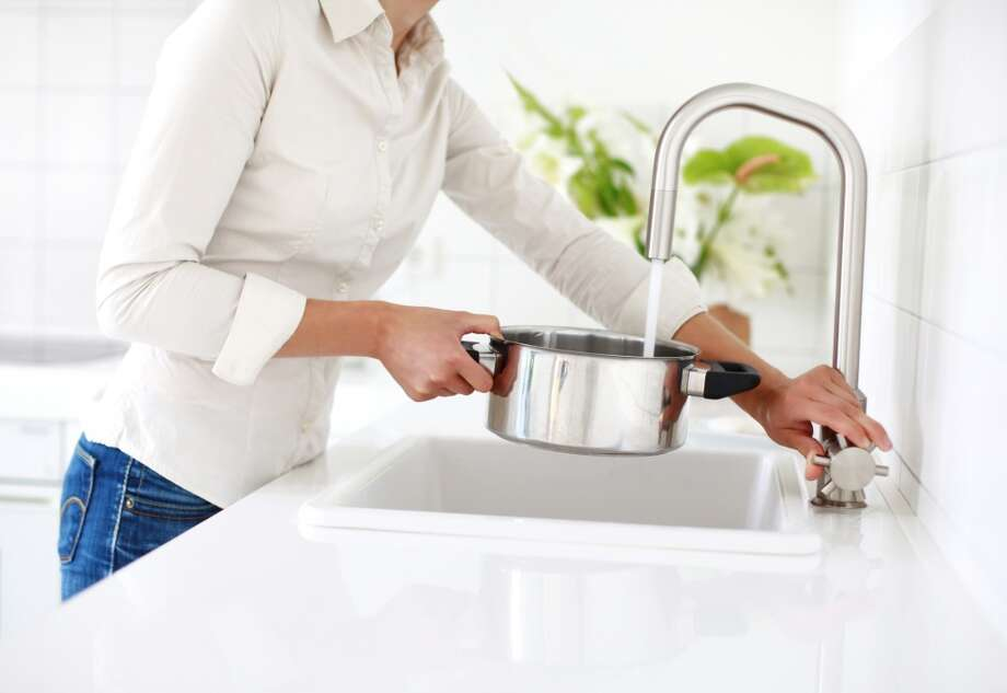 Soak dirty pots and pans instead of running the water while you scrape them clean. Photo: TommL, Getty Images/Vetta