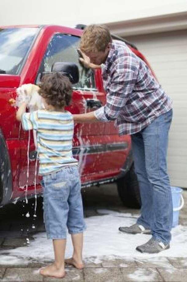 Wash your car with a bucket, sponge, and hose with self-closing nozzle. It saves 8-18 gallons per minute. Photo: Hybrid Images, Getty Images/Cultura RF