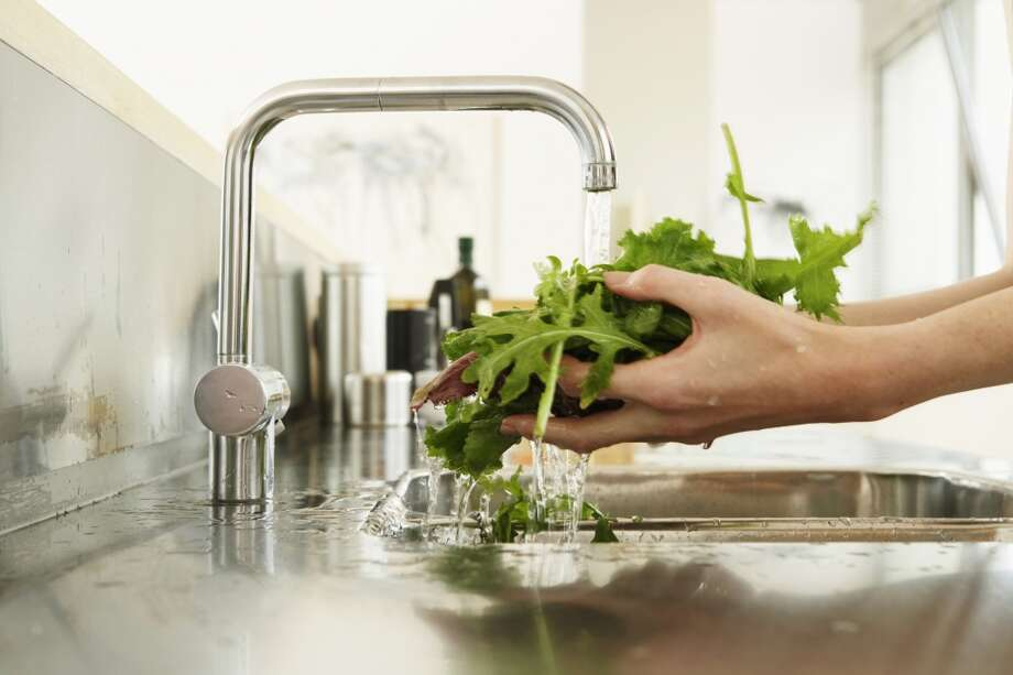 Don't let the water drain away when you're rinsing fruits and veggies. Collect it in a bowl and use to water your houseplants. Photo: Tay Jnr, Getty Images