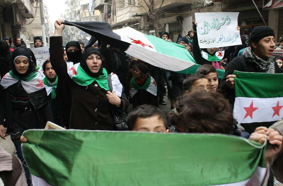 Aleppo residents protest the government siege of a Palestinian refugee camp in southern Damascus. Photo: Mohammed Al-khatieb, AFP/Getty Images