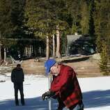 Frank Gehrke, chief of snow surveys for the California Department of Water Resources, measures snow levels near Echo Summit, Calif., Friday, Jan. 3, 2014. The readings Friday showed the water content in the statewide snowpack at just 20 percent of average for this time of year.