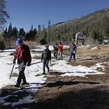 Frank Gehrke, chief of snow surveys for the California Department of Water Resources, left, leads his group out to measure snow levels near Echo Summit, Calif., on Friday, Jan. 3, 2014. The readings Friday showed the water content in the statewide snowpack at just 20 percent of average for this time of year.