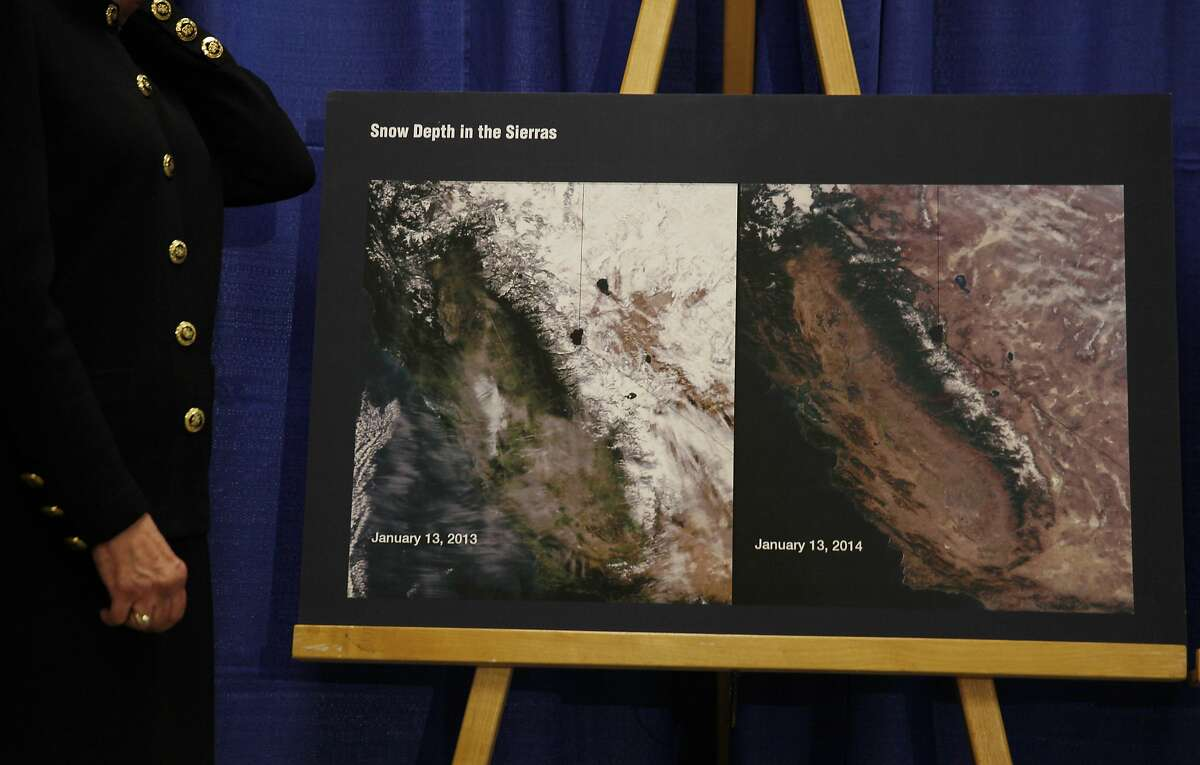 Karen Ross (left), Secretary of Department of Food and Agriculture stands next to a chart comparing photos from January 13, 2013 and January 13, 2014 showing snow depth in the Sierras during a press conference in which California Governor Jerry Brown declared a drought State of Emergency on Friday, January 17, 2014 in San Francisco.