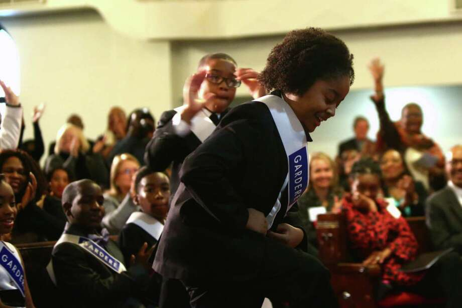 Amari Venzor, 10, wins first place at the 18th Annual Gardere MLK Jr. Oratory Competition, Friday, Jan. 17, 2014, in Houston. Venzor is a fifth grade student at Cornelius Elementary School. Venzor says it took him about three days to memorize his part and the help of his family to get the gesture and body language right for his speech. Photo: Marie D. De Jesus, Houston Chronicle / © 2014 Houston Chronicle