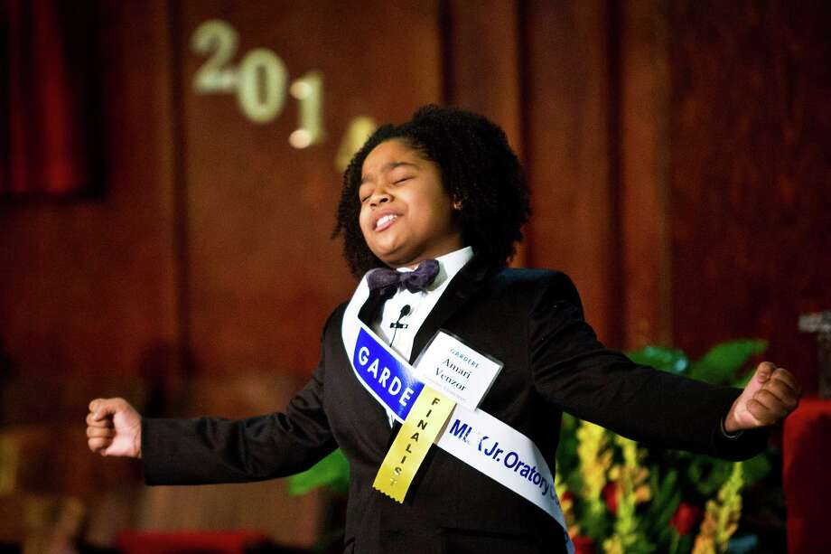 "Winner Amari Venzor, 10, gives a speech paying tribute to the 50th anniversary of the civil rights leader's iconic ""I Have a Dream"" speech by Dr. Martin Luther King Jr. winning first place at the at the 18th Annual Gardere MLK Jr. Oratory Competition, Friday, Jan. 17, 2014, in Houston. Venzor who is a fifth grade student at Cornelius Elementary School spoke about the importance of education, "" your education is the key to open the door of your opportunities"" he said. Photo: Marie D. De Jesus, Houston Chronicle / © 2014 Houston Chronicle"