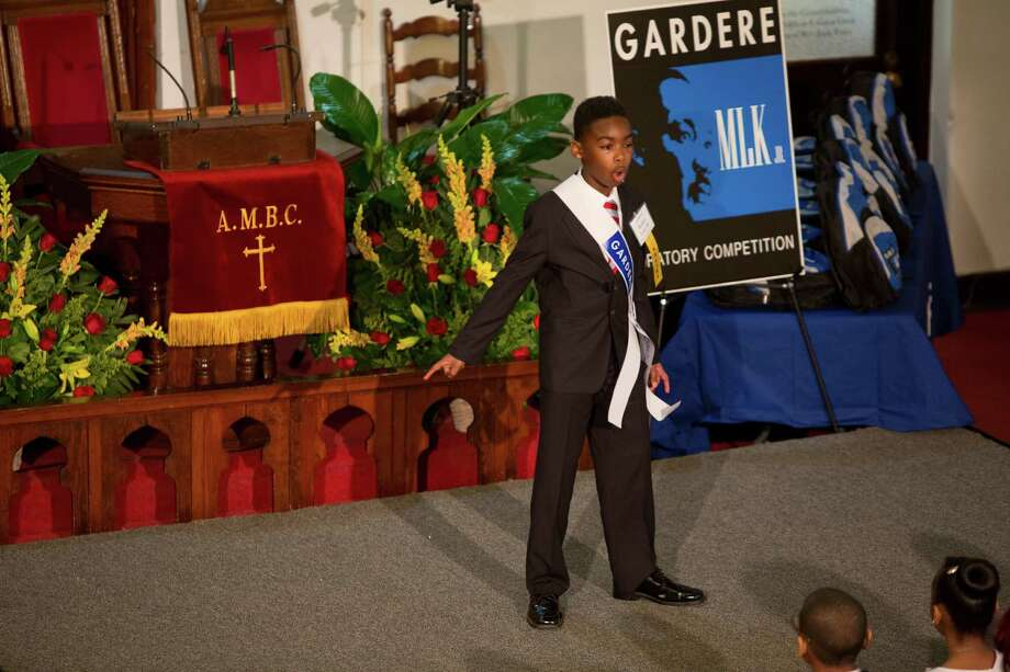 Robert Lane III, is the first finalist to take the stage and give his speech honoring the legacy of Dr. Martin Luther King Jr. during the 18th Annual Gardere MLK Jr. Oratory Competition, Friday, Jan. 17, 2014, in Houston. Lane is a fifth grader at Valley West Elementary School. Photo: Marie D. De Jesus, Houston Chronicle / © 2014 Houston Chronicle