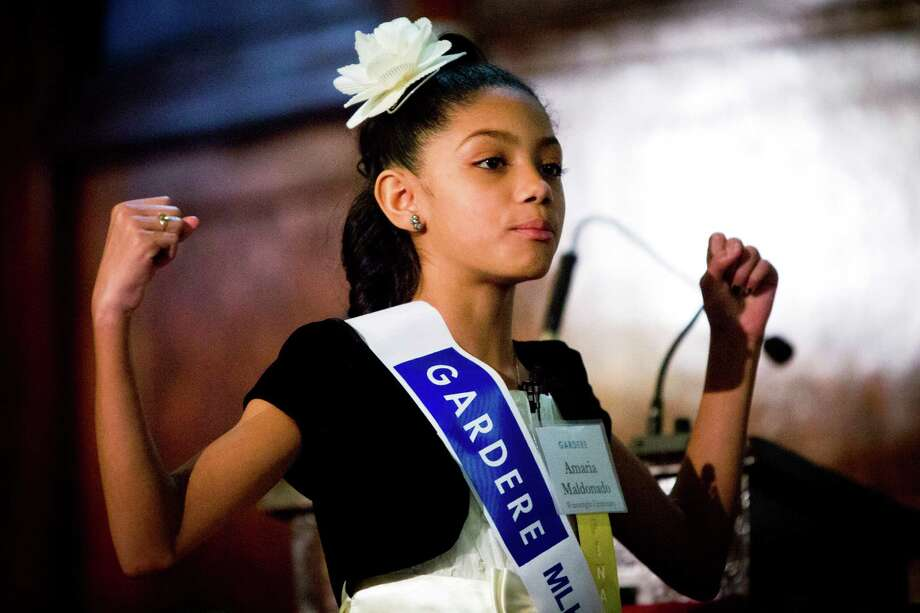 Amaria Maldonado of Wainwright Elementary School delivers her speech at the at the Antioch Missionary Baptist Church in Houston during the 18th Annual Gardere MLK Jr. Oratory Competition, Friday, Jan. 17, 2014. Photo: Marie D. De Jesus, Houston Chronicle / © 2014 Houston Chronicle