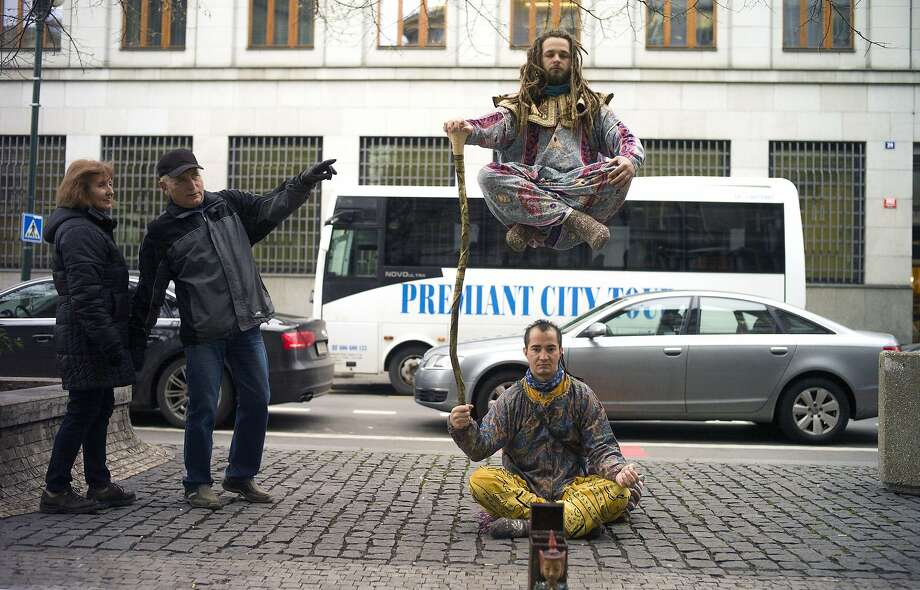 Kiting a Czech: Street performers add a little levity, not to mention levitation, to a downtown sidewalk in Prague. Photo: Michal Cizek, AFP/Getty Images
