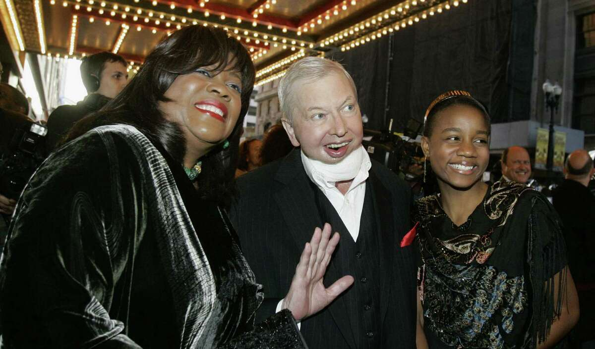 Film critic Roger Ebert, is flanked by wife Chaz (left) and their granddaughter, Raven Evans, in 2007.