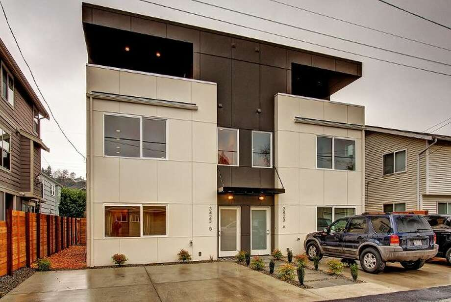 First comes the home closest to our target price, 3423B 33rd Ave. W., which is listed for $489,000. The 1,541-square-foot house, completed this year, has three bedrooms, 2.25 bathrooms and a balcony. An open house is scheduled for 11 a.m. to 3 p.m. on Saturday. Photo: Courtesy Heidi Ward, Windermere Real Estate