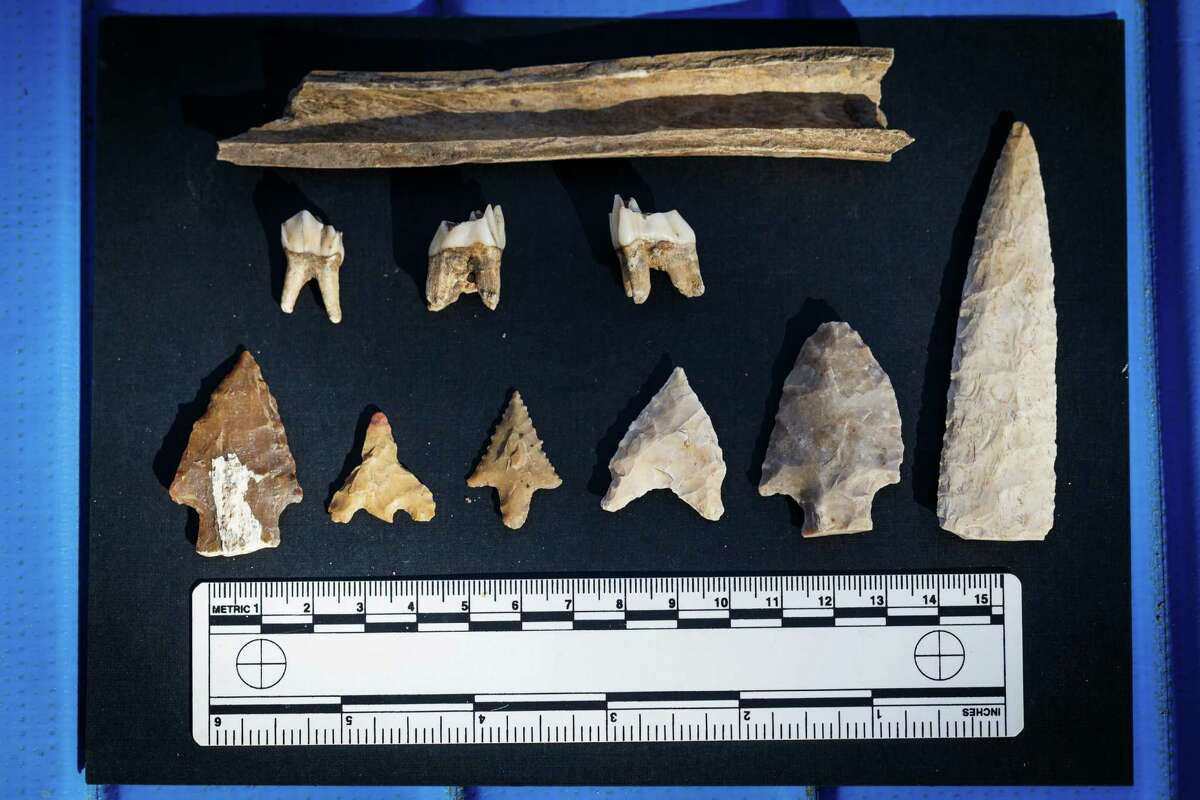 Ancient artifacts, including dart points, arrowheads, teeth, bones and tools, have been found in the excavated dirt gathered from under the Grand Parkway in Cypress. Hunters and gatherers traded goods more than 10,000 years ago at a creekside mound that's now under the parkway.
