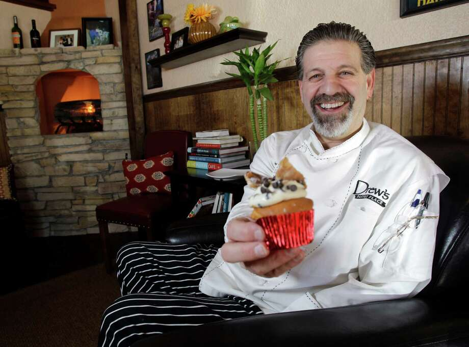"""Drew Rogers owner and chef of Drew's Pastry Place, 10300 Louetta Road, poses with a cannoli cupcake in his redesigned bakery Wednesday, Jan. 15, 2014, in Houston. He recently took part in the TLC television show  """"Bakery Boss"""" and the episode is schedule to air on Jan. 20. ( Melissa Phillip / Houston Chronicle ) Photo: Melissa Phillip, Staff / © 2014  Houston Chronicle"""