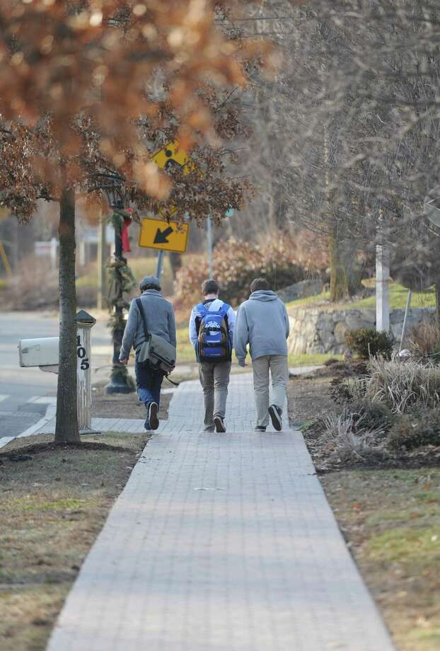 A group of boys walk to the end of the sidewalk along Church Hill Road in Sandy Hook, Conn. on Friday, Jan. 17, 2014.  Thanks to donations, the town plans to build a sidewalk along Church Hill Road from the flagpole in Newtown to Dickenson Drive in Sandy Hook. Photo: Tyler Sizemore / The News-Times