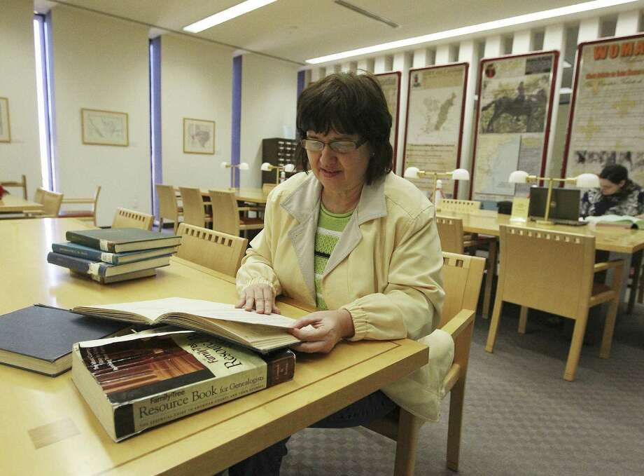 Joy Asbury of New Braunfels scours census archives at the San Antonio Main Library's Texana and Genealogy Department. Photo: Kin Man Hui / San Antonio Express-News / ©2013 San Antonio Express-News