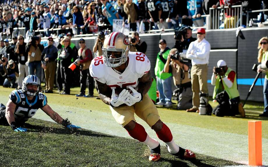 Vernon Davis' foot-dragging catch in the 49ers' 23-10 win Sunday against Carolina gave him seven postseason TDs for his career, tying Dave Casper's record. Photo: Grant Halverson, Getty Images