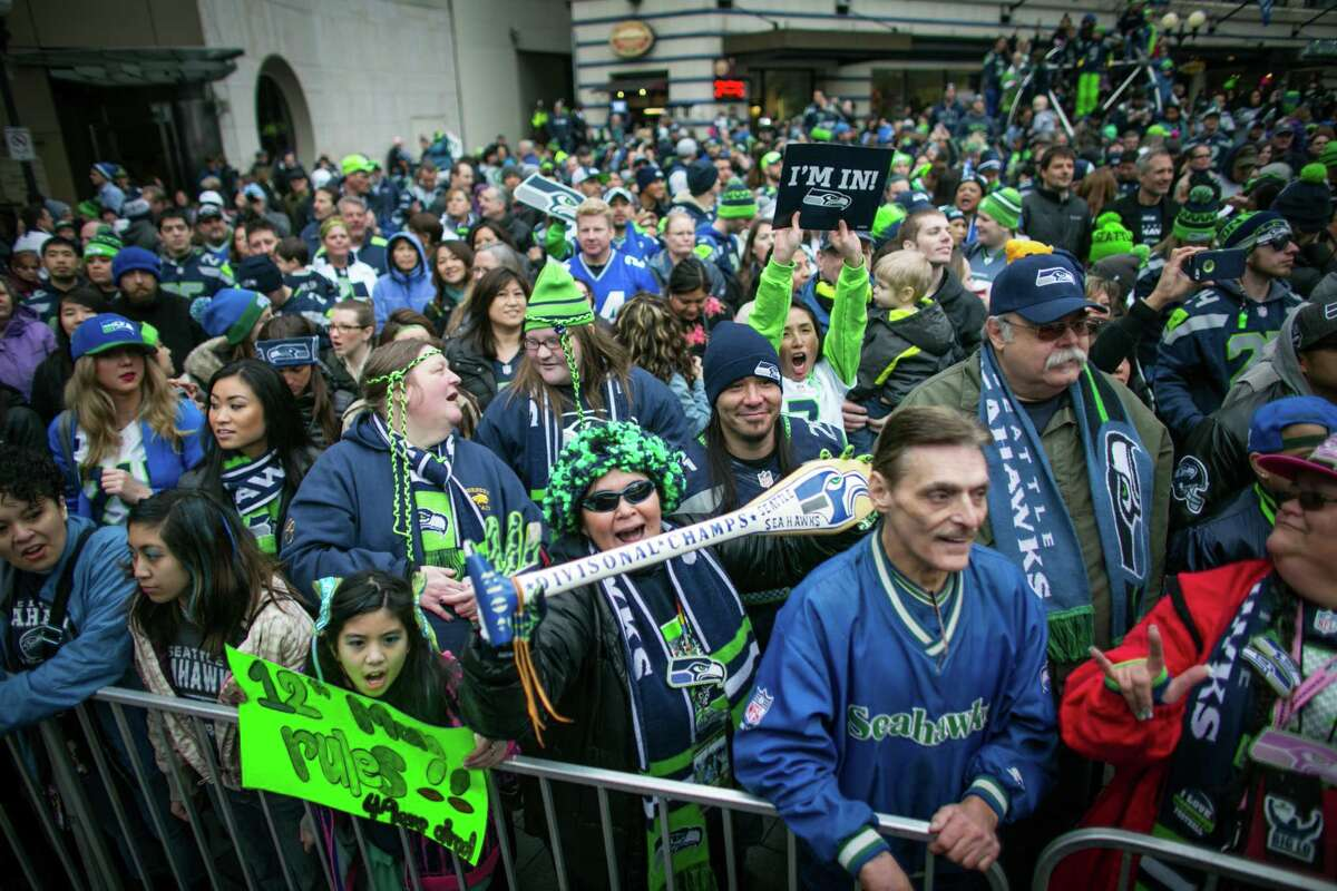 Seattle Seahawks fans gather at Westlake Park for a fan rally on Friday, January 17, 2014 before Sunday's NFC Championship game between the Seahawks and 49ers. Thousands of fans showed up for the rally.