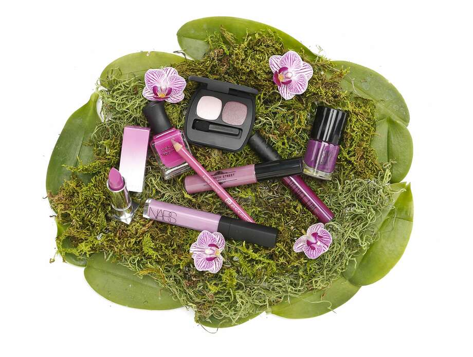 Radiant Orchid, the Pantone color of 2014, offers multiple wearable options for beauty, from eyes and cheeks to lips and nails. Clockwise, from top center: bareMinerals Ready Eyeshadow 2.0 in the Inspiration, $20; Topshop Velvet Lips in Plush, $20; Elizabeth Street Cosmetics Lilac Street Gloss, $23; Lux Movies in the Castro: Darkened Neon Purple, $9.50; Nars Années Folles Larger Than Life in Sheer Violet, $26; Sephora + Pantone Radiant Rush Matte lipstick, $18; Deborah Lippman Between the Sheets polish, $17; essence Kajal Pencil in Pretty in Fuchsia, $.99. Photo: Russell Yip, The Chronicle