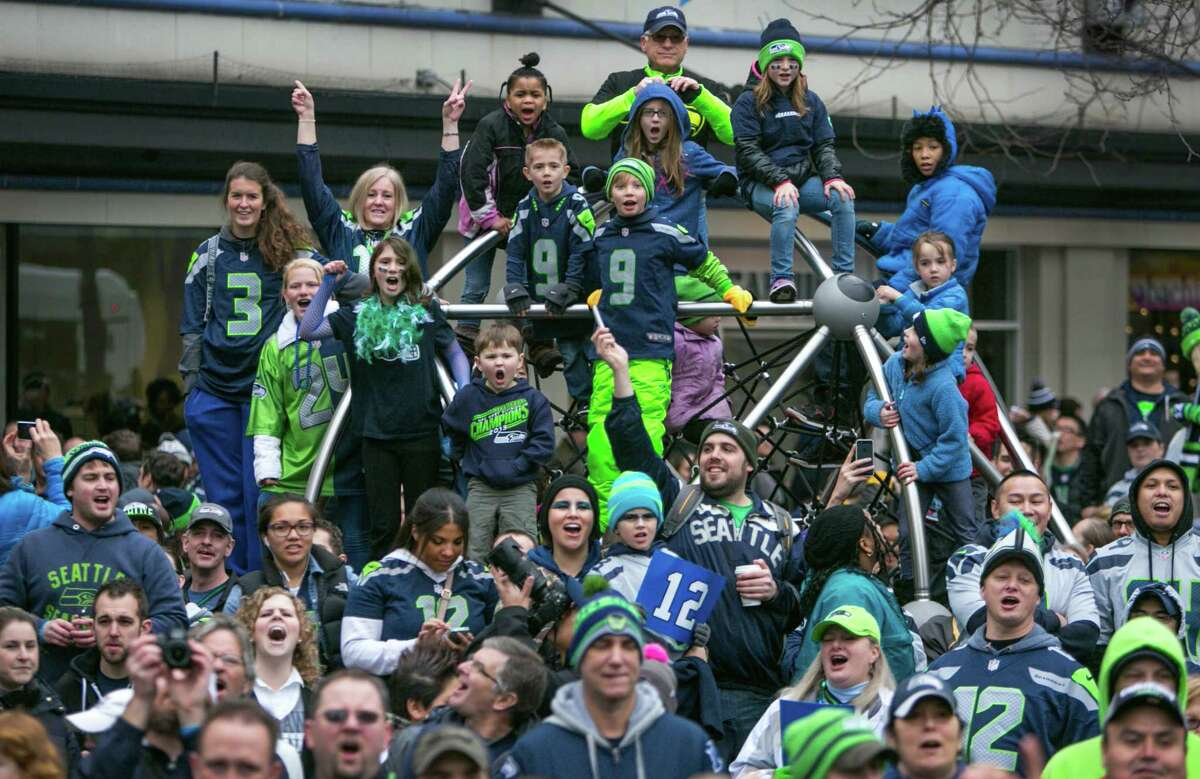 Seattle Seahawks fans gather on a play structure at Westlake Park for a fan rally on Friday, January 17, 2014 before Sunday's NFC Championship game between the Seahawks and 49ers. Thousands of fans showed up for the rally.