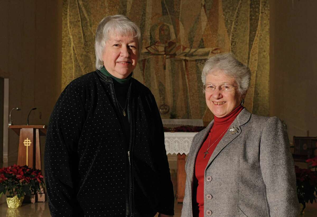 Sisters Carol Davis, O.P., left, and Doreen Glynn, CSJ stand in front of the Alter in the chapel at St. Joseph's Provincial House on Tuesday, Jan. 14, 2014 in Latham, N.Y. The two will be leading a vigil against human trafficking on Thursday, Jan. 23, at St. Joseph's Provincial House. (Lori Van Buren / Times Union)