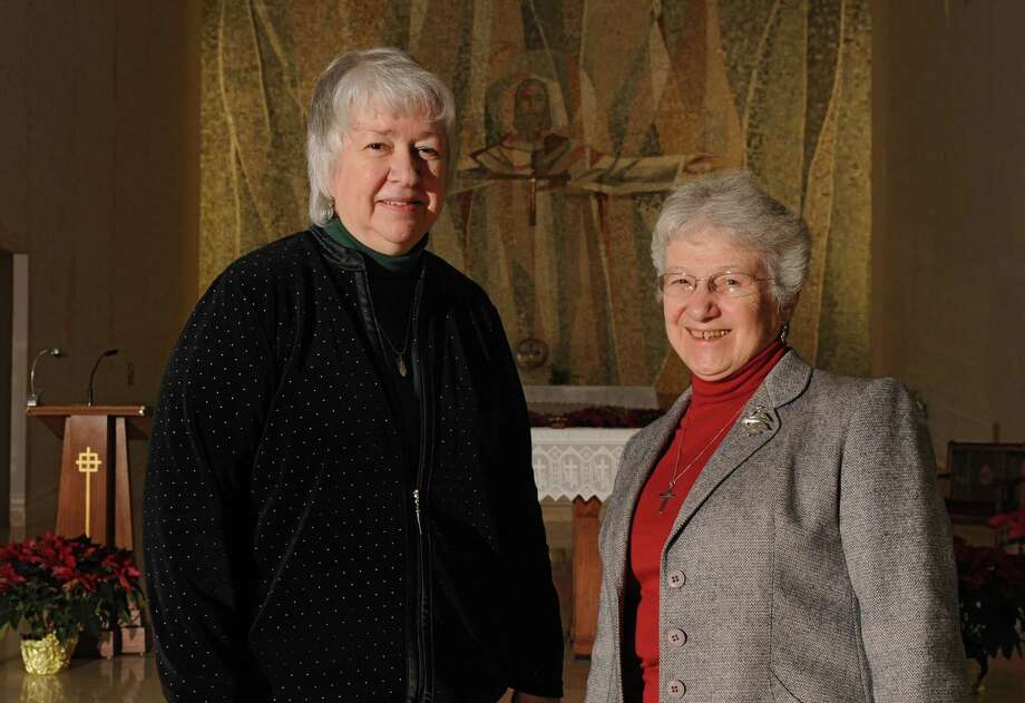 Sisters Carol Davis, O.P., left, and Doreen Glynn, CSJ stand in front of the Alter in the chapel at St. Joseph's Provincial House on Tuesday, Jan. 14, 2014 in Latham, N.Y.  The two will be leading a vigil against human trafficking on Thursday, Jan. 23, at St. Joseph's Provincial House. (Lori Van Buren / Times Union) Photo: Lori Van Buren / 00025284A