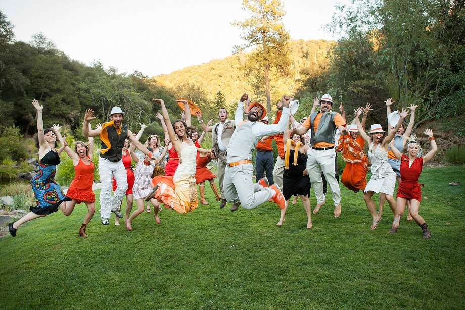 At the weekend wedding of Karim Bishay and Marielle Amrhein, top, subtitled Lovefest Extravaganza of Awesomeness, in the Sierra Nevada foothills, the couple celebrate with family and friends; share a kiss; and prove that they are truly head over heels in love. Photo: Paige Green Photography