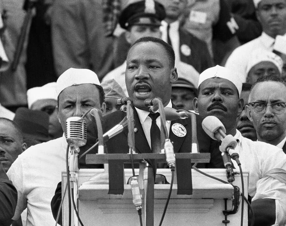 "In this Aug. 28, 1963 file photo, Dr. Martin Luther King Jr., head of the Southern Christian Leadership Conference, addresses marchers during his ""I Have a Dream"" speech at the Lincoln Memorial in Washington. (AP Photo/File) Photo: STF / AP"