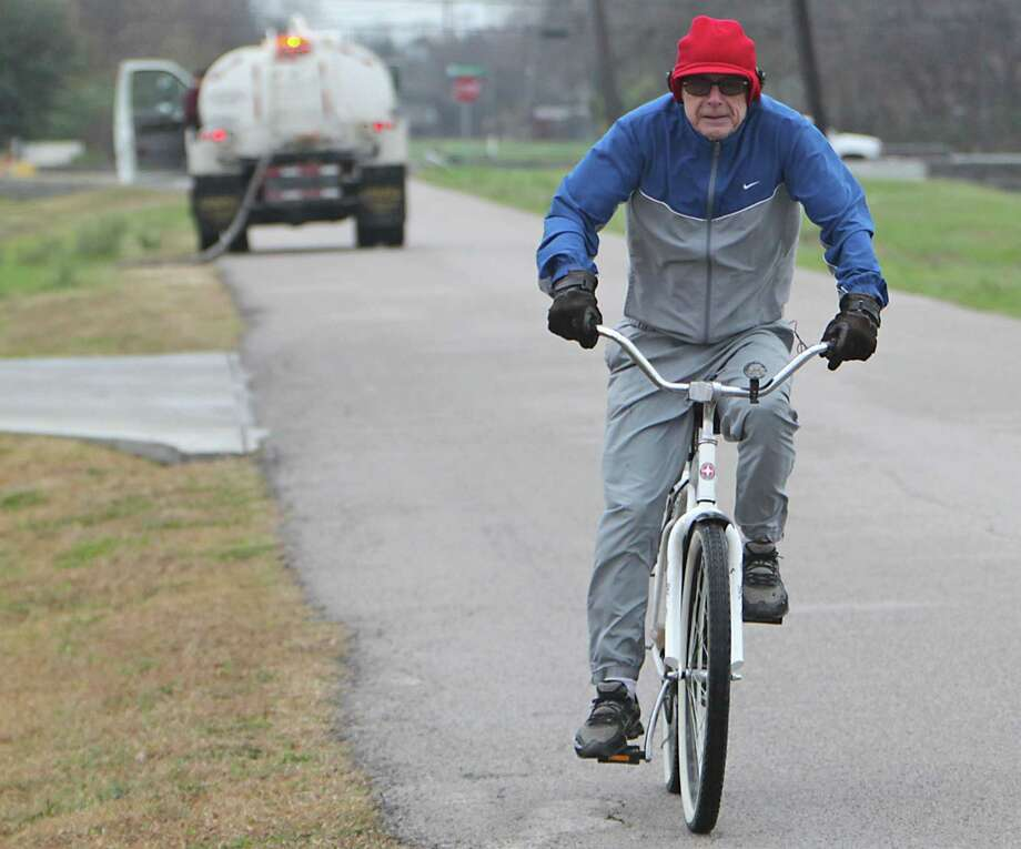 Cliff Howard rides a bicycle on Spence road as a cold front  moves through the area Sunday, Jan. 5, 2014, in Houston.  ( James Nielsen / Houston Chronicle ) Photo: James Nielsen, Staff / © 2013  Houston Chronicle