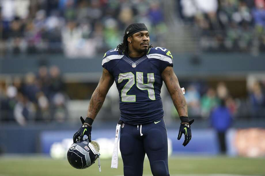 Marshawn Lynch has hit his stride in Seattle, rushing for 4,624 yards in parts of four seasons. Photo: Elaine Thompson, Associated Press