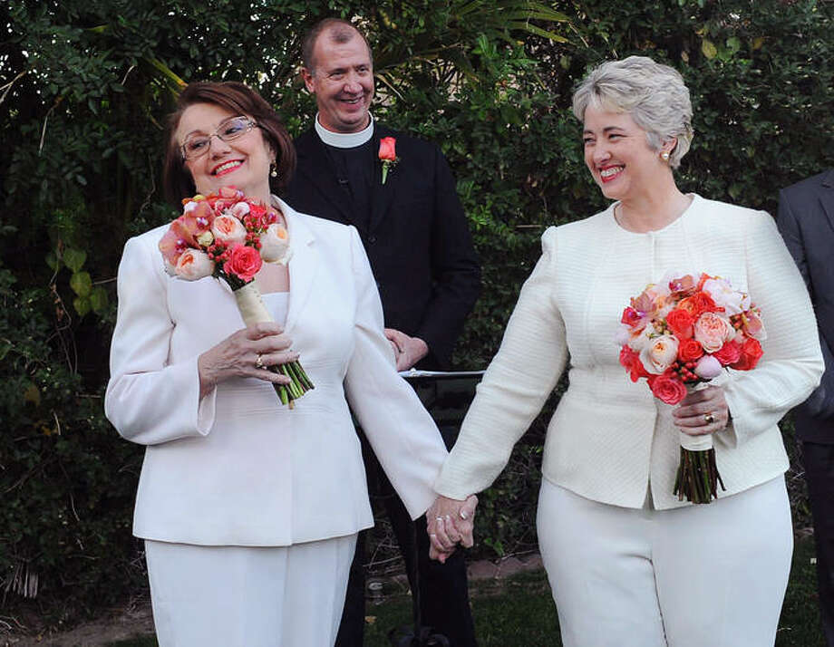 In this photo provided by the Houston mayor's office, Houston Mayor Annise Parker, right and her long-time partner, First Lady Kathy Hubbard, celebrate at their wedding Thursday, Jan 16, 1014 in Palm Springs, Calif. The ceremony was performed by the Rev. Paul Fromberg, rear, rector of St. Gregory of Nyssa Episcopal Church in San Francisco. (AP Photo/Houston Office of The Mayor, Richard Hartog) Photo: Richard Hartog, HOPD / Houston Office of The Mayor
