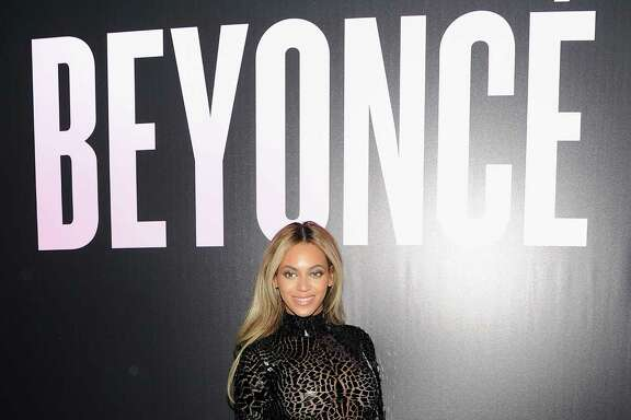 "NEW YORK, NY - DECEMBER 21:  Entertainer Beyonce attends a release party and screening for her new self-titled album ""Beyonce"" at the School of Visual Arts Theater on December 21, 2013 in New York City.  (Photo by Jamie McCarthy/Getty Images)"